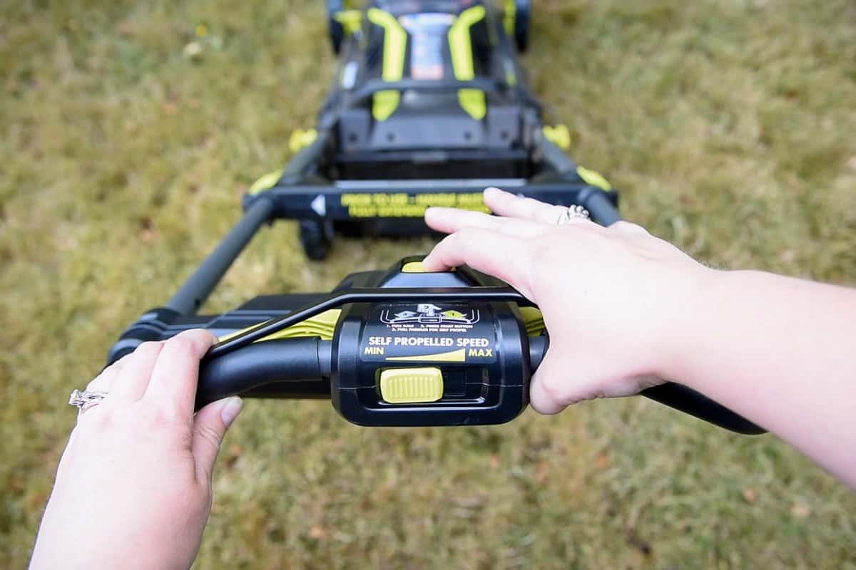 starting the Ryobi electric lawn mower