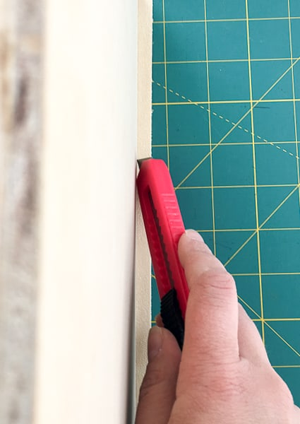 trimming sides of edge banding with a utility knife