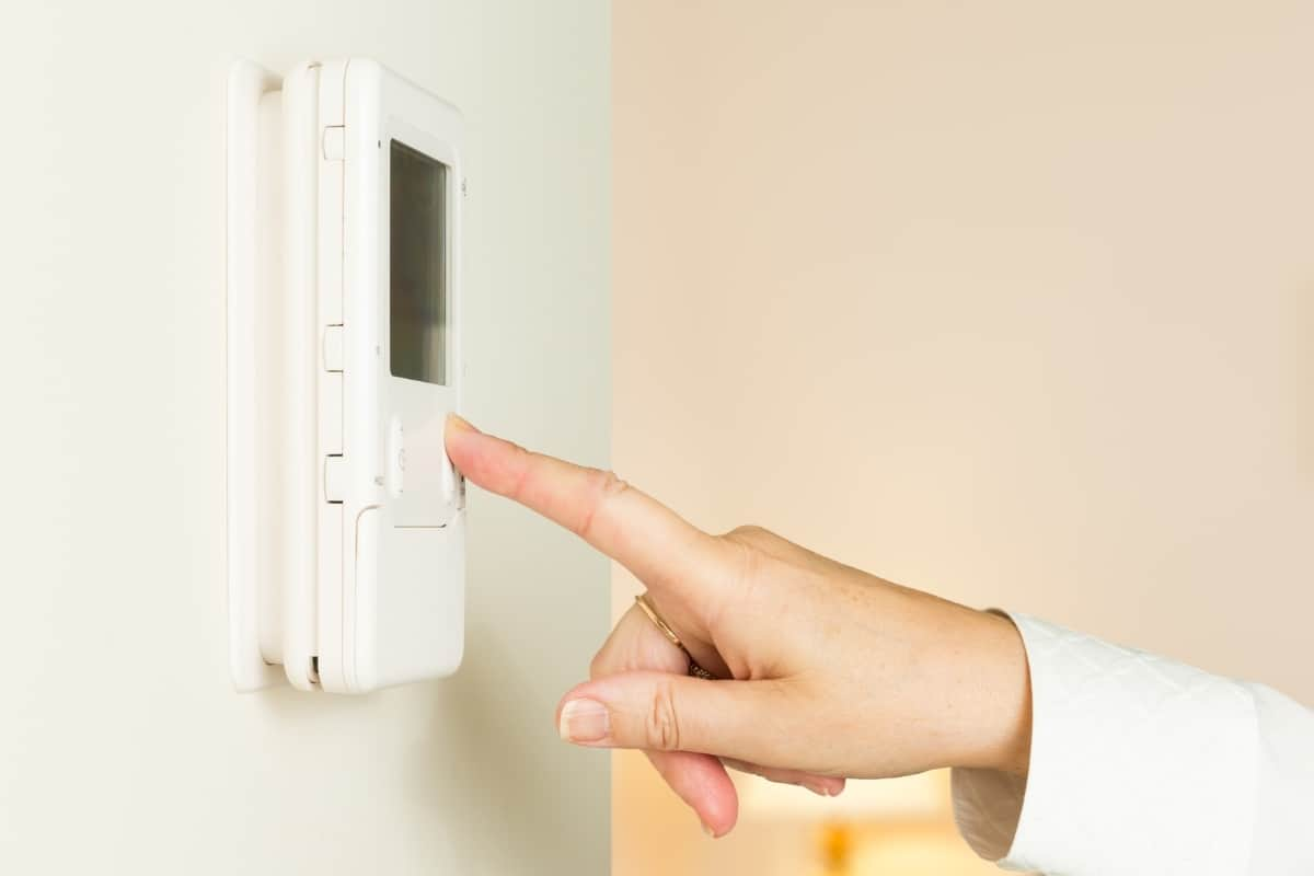 adjusting the thermostat fan setting to AUTO to stop the furnace blowing cold air