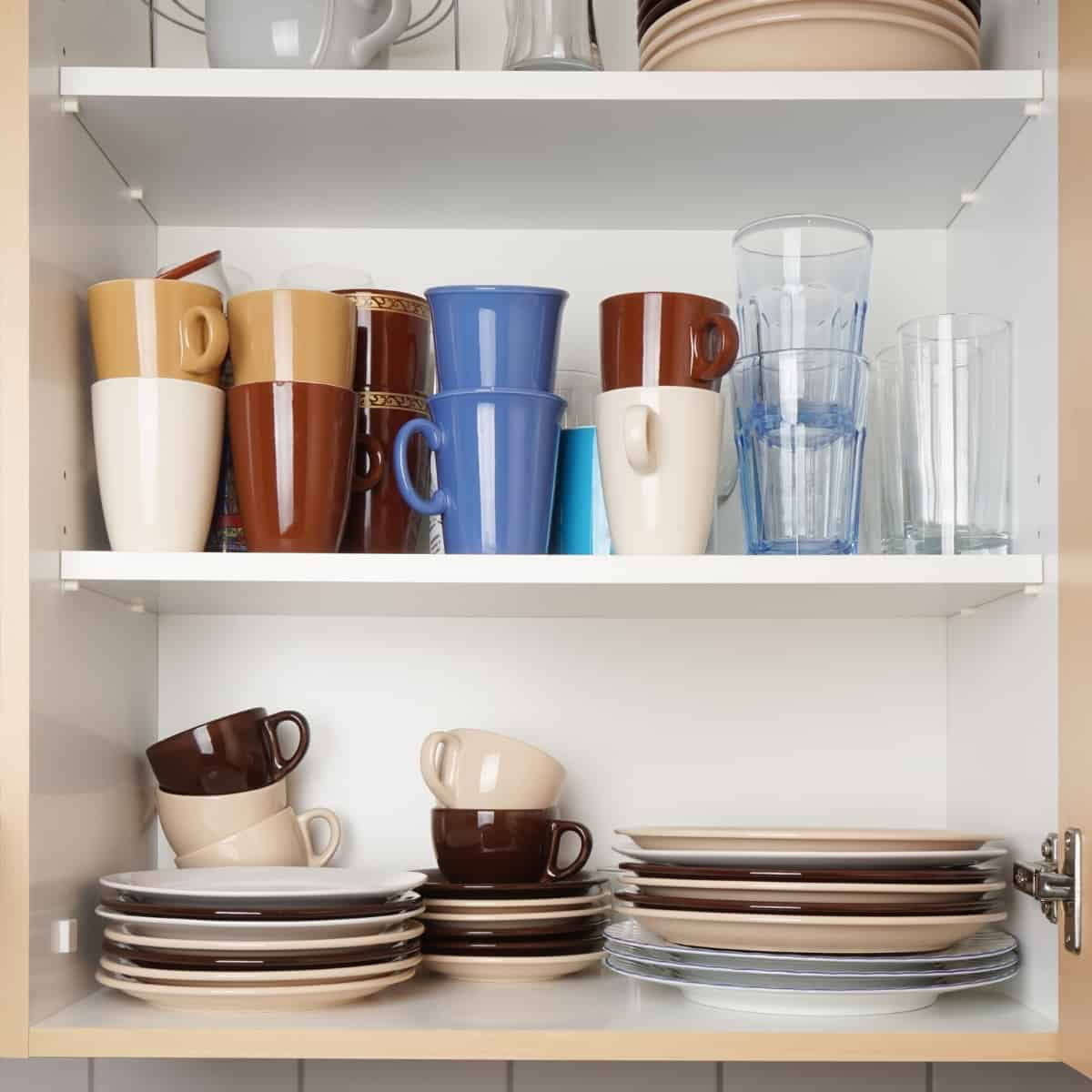 frameless cabinet with dishes on shelves