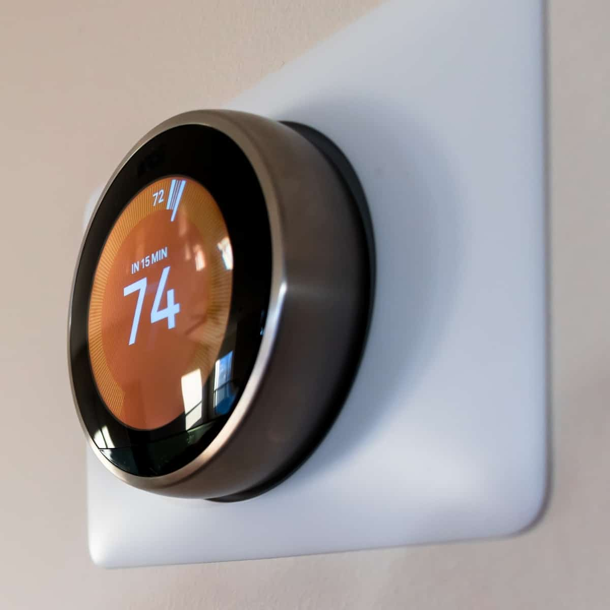 modern thermostat with wall plate