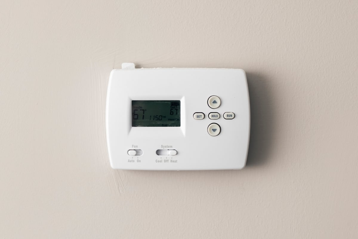 thermostat with dim screen on the wall