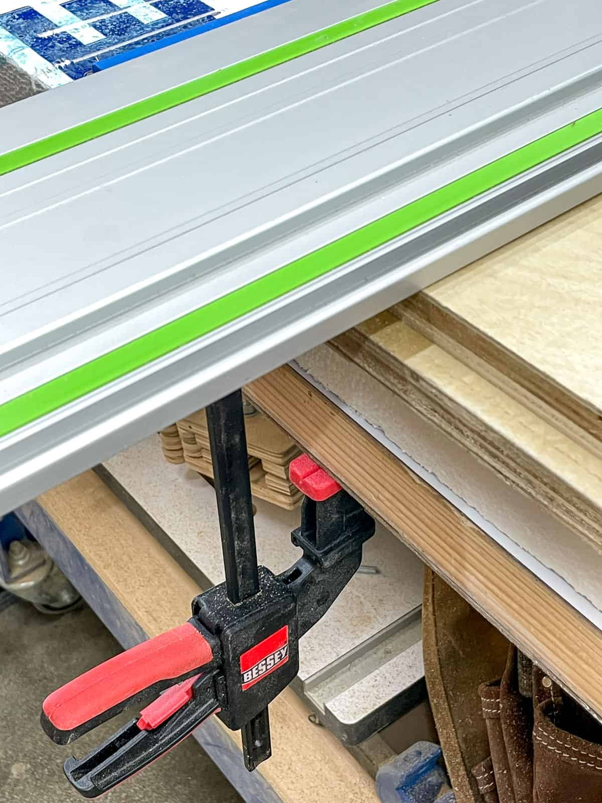 track for track saw secured to workbench with bessey clamp