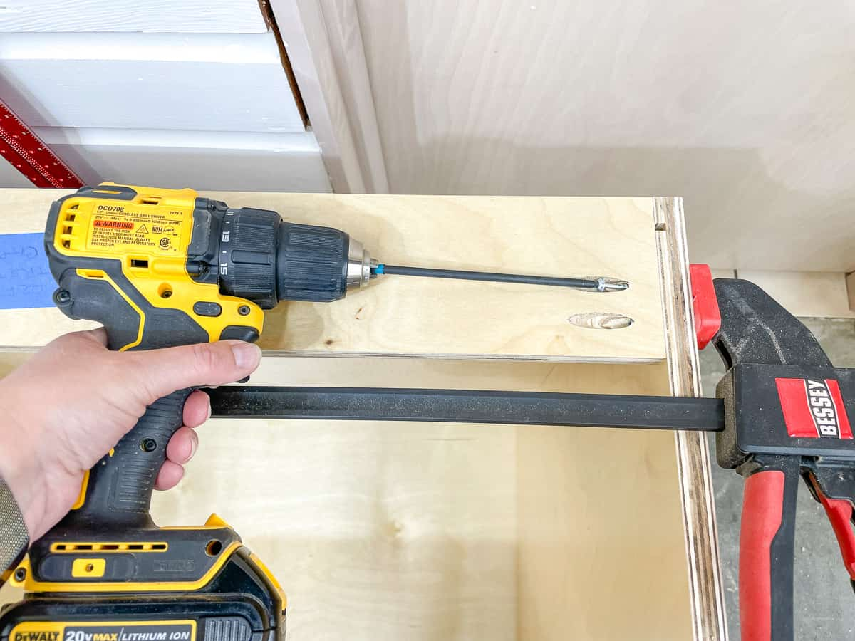 attaching the back stretcher to the cabinet box with pocket hole screws