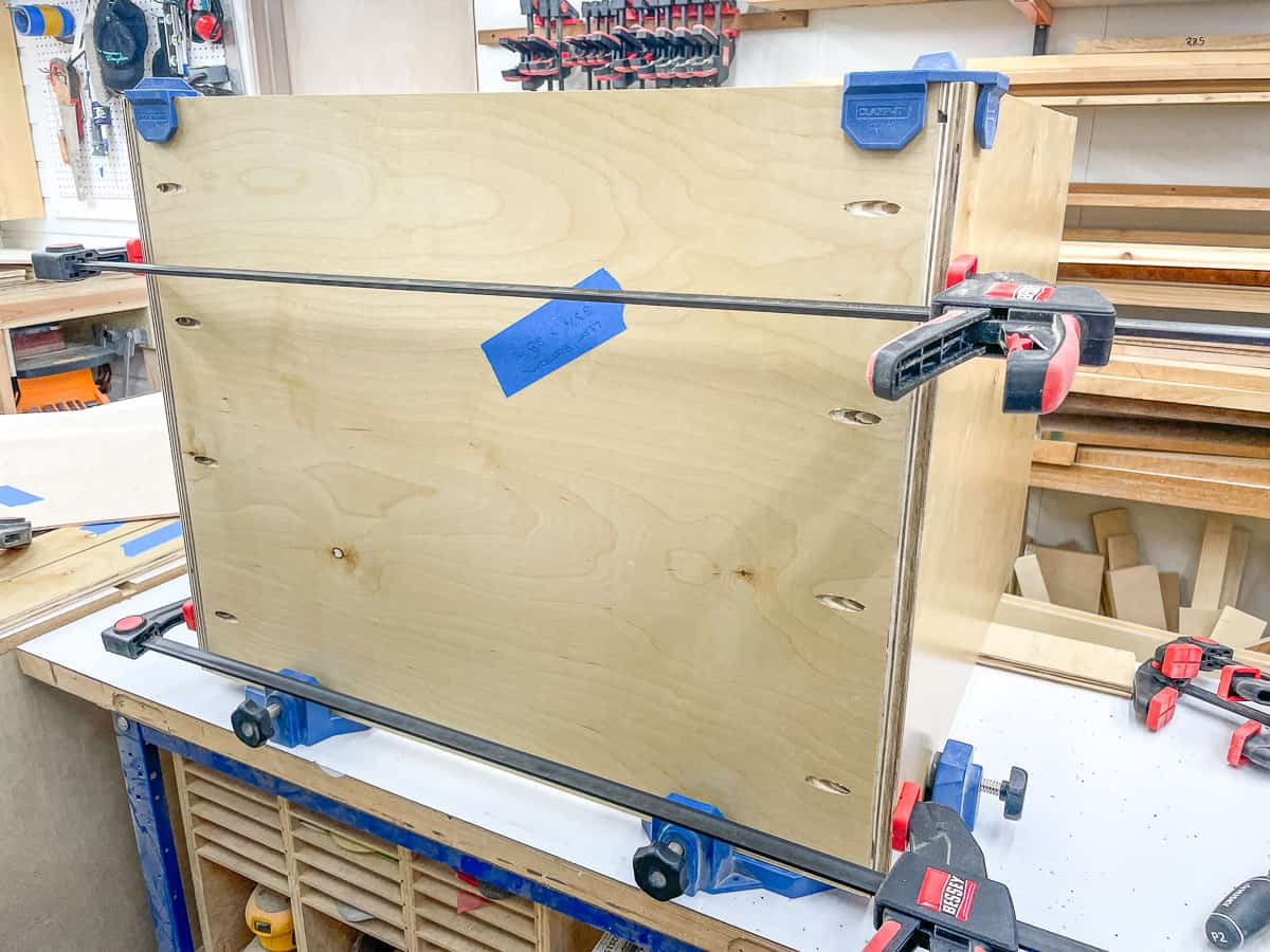 bottom and sides of the basic cabinet box clamped together