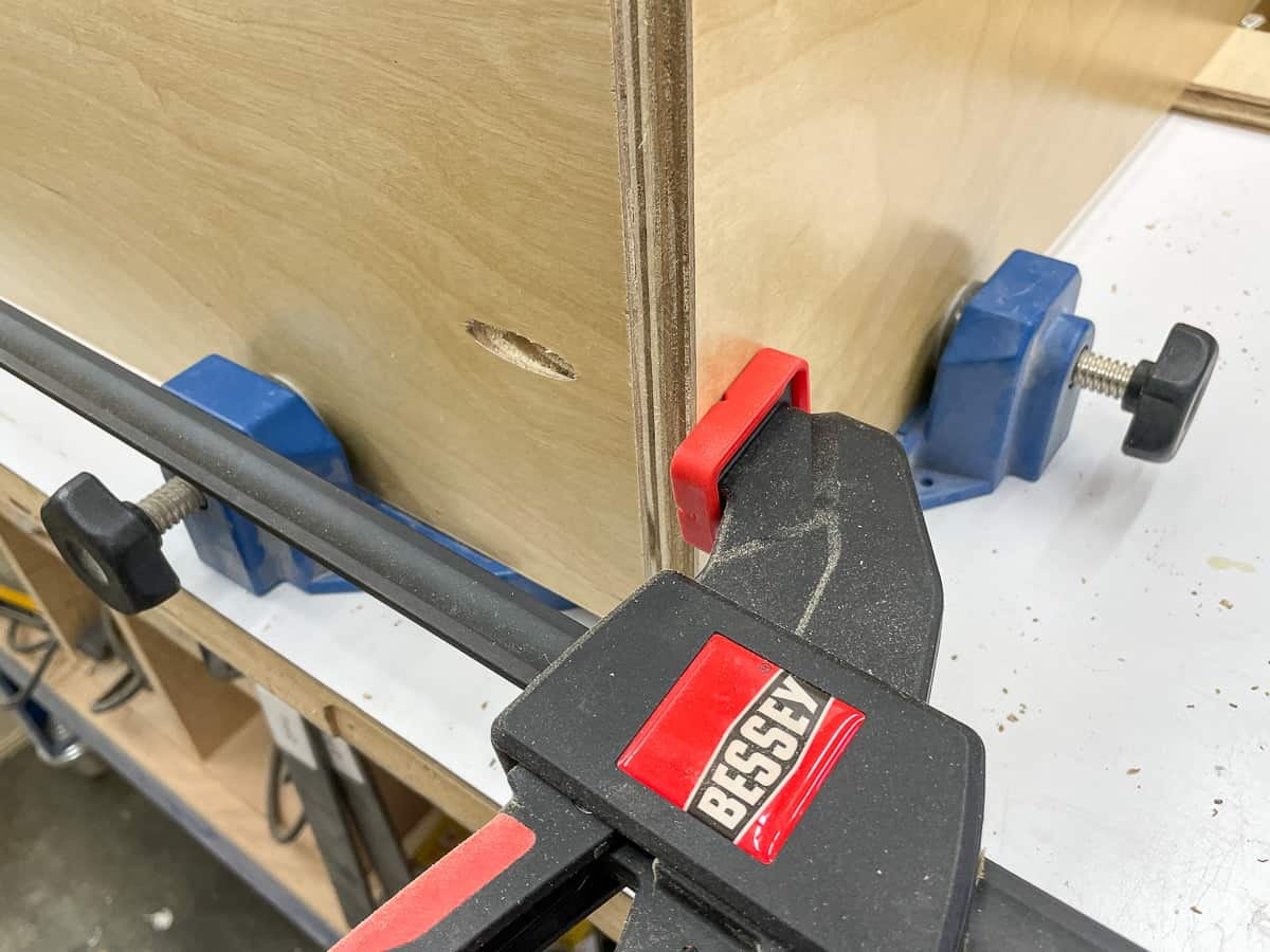 corner of cabinet box clamped together