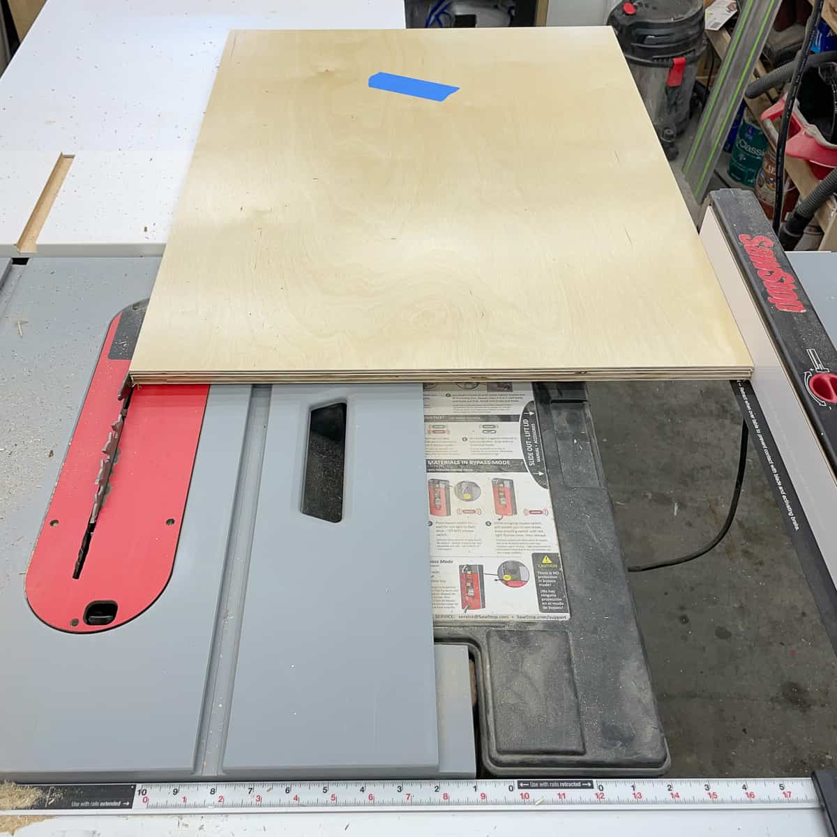 cutting cabinet box side to final width at the table saw