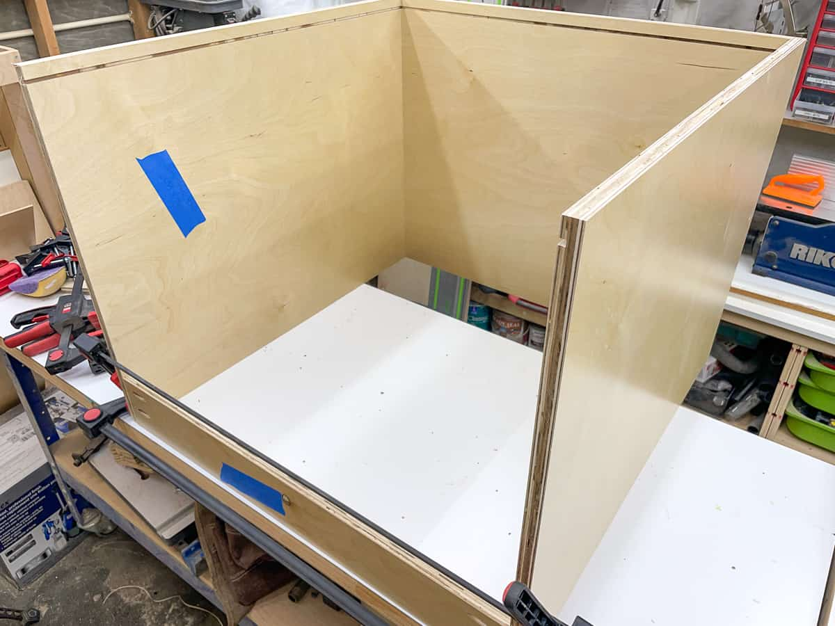 attaching the front stretcher to the cabinet box