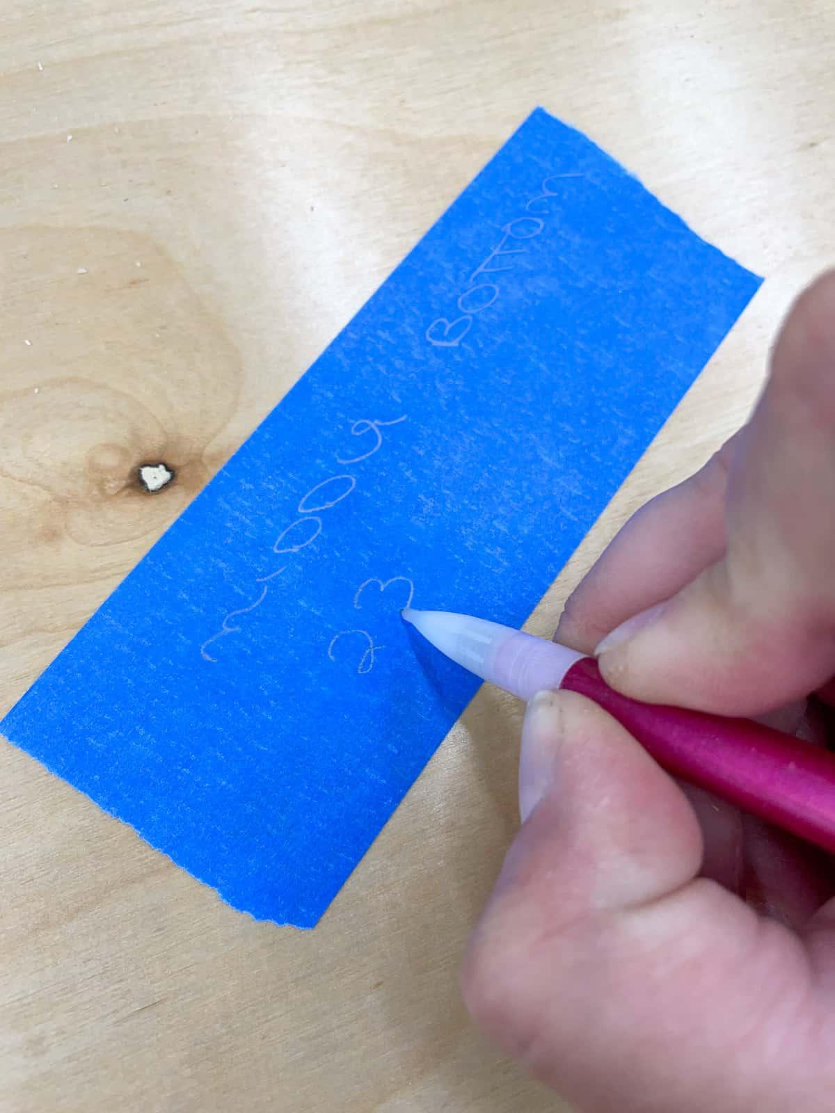 blue painter's tape label on cabinet box parts