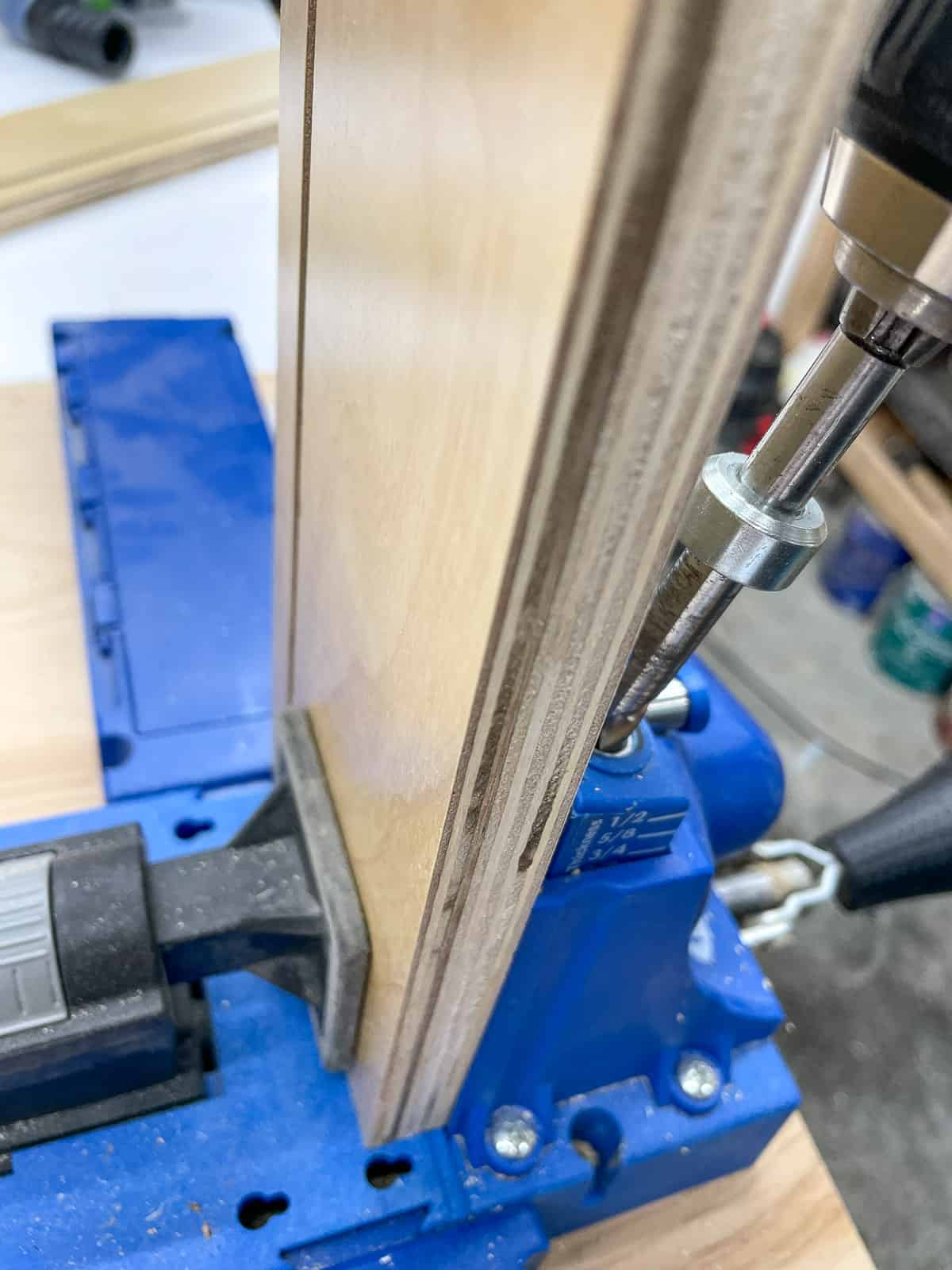 drilling pocket holes in drawer box front opposite from the groove
