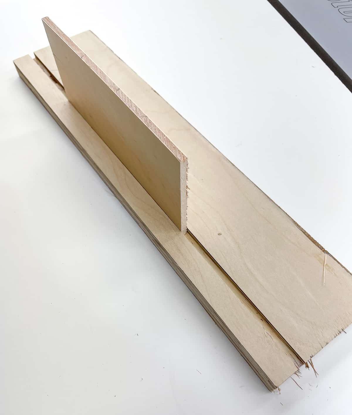 testing fit of the bottom of the drawer box in the groove