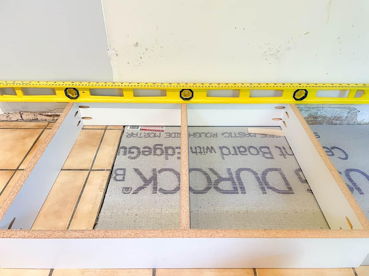toe kick platform level over tile and cement board floor