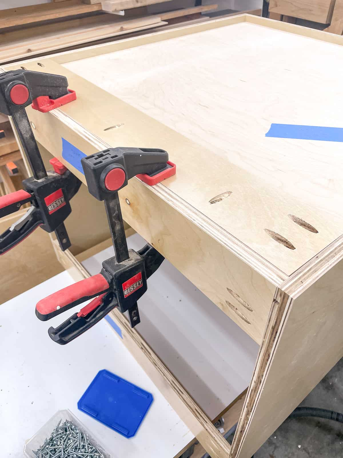 top nailer strip clamped to the back of the cabinet box