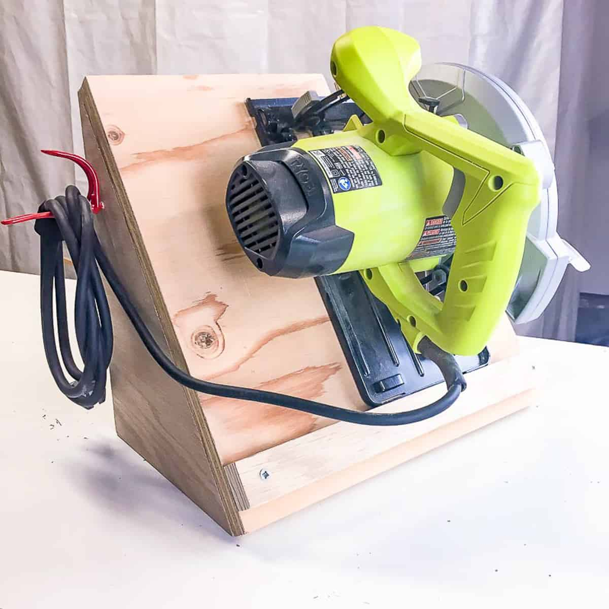 side of circular saw storage rack with cord hook