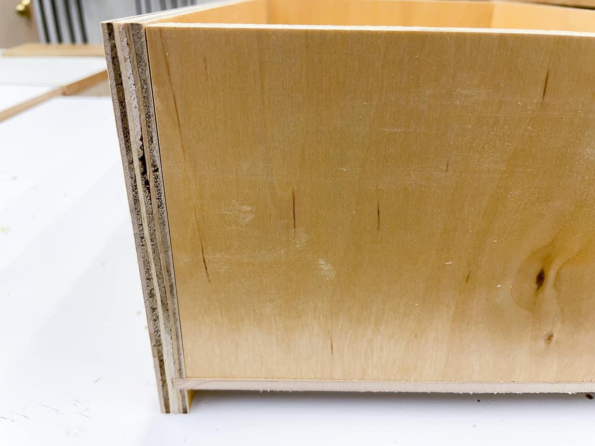 back of drawer box resting on bottom