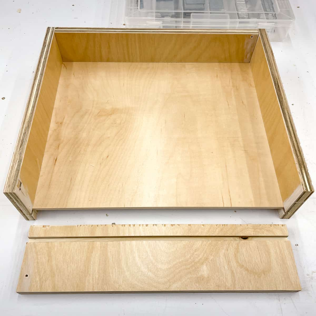 drawer with captured bottom assembled on three sides
