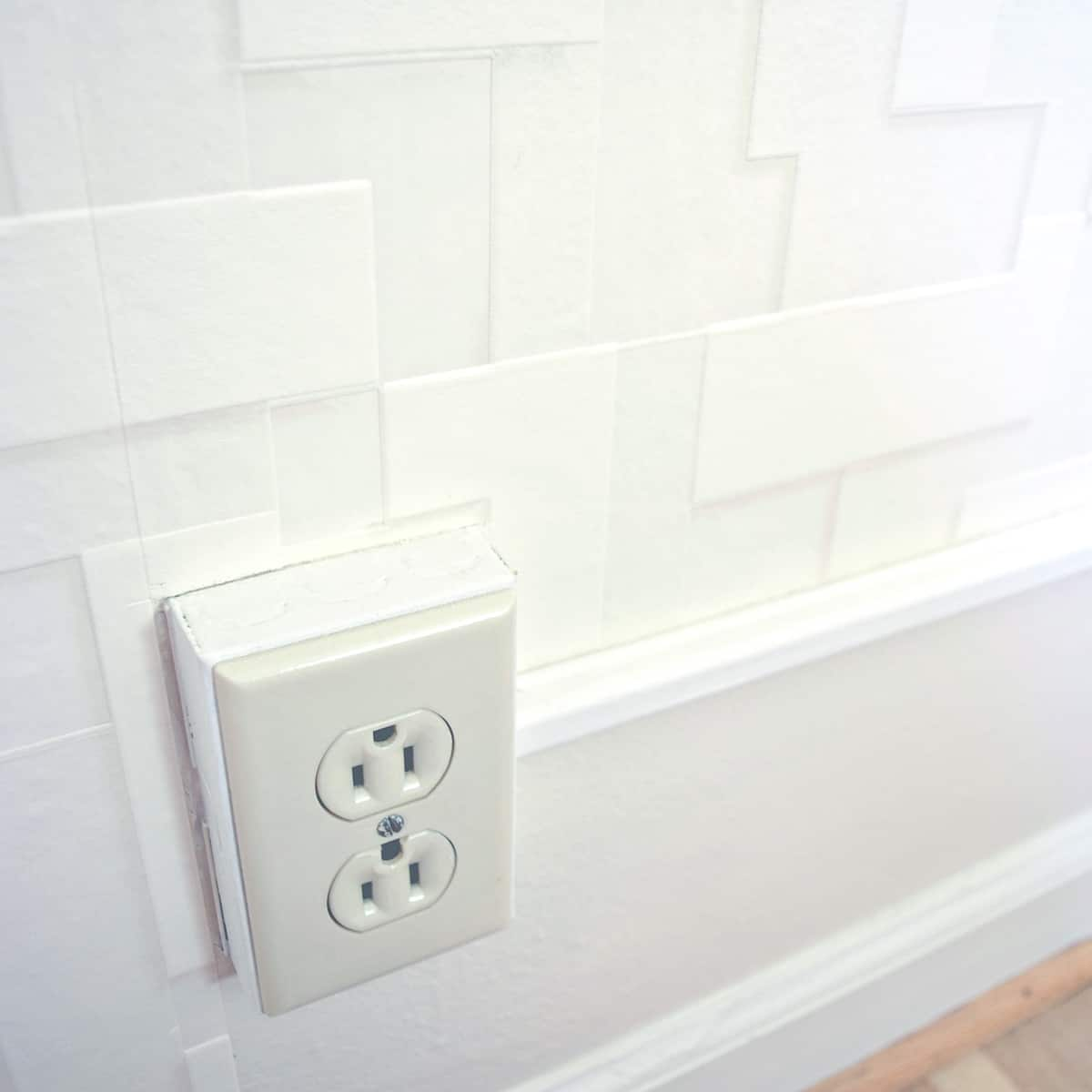 wallpaper around outlet and conduit