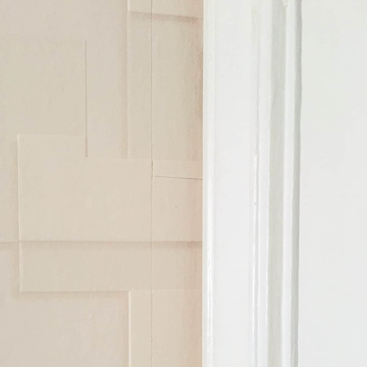 textured wallpaper behind door trim