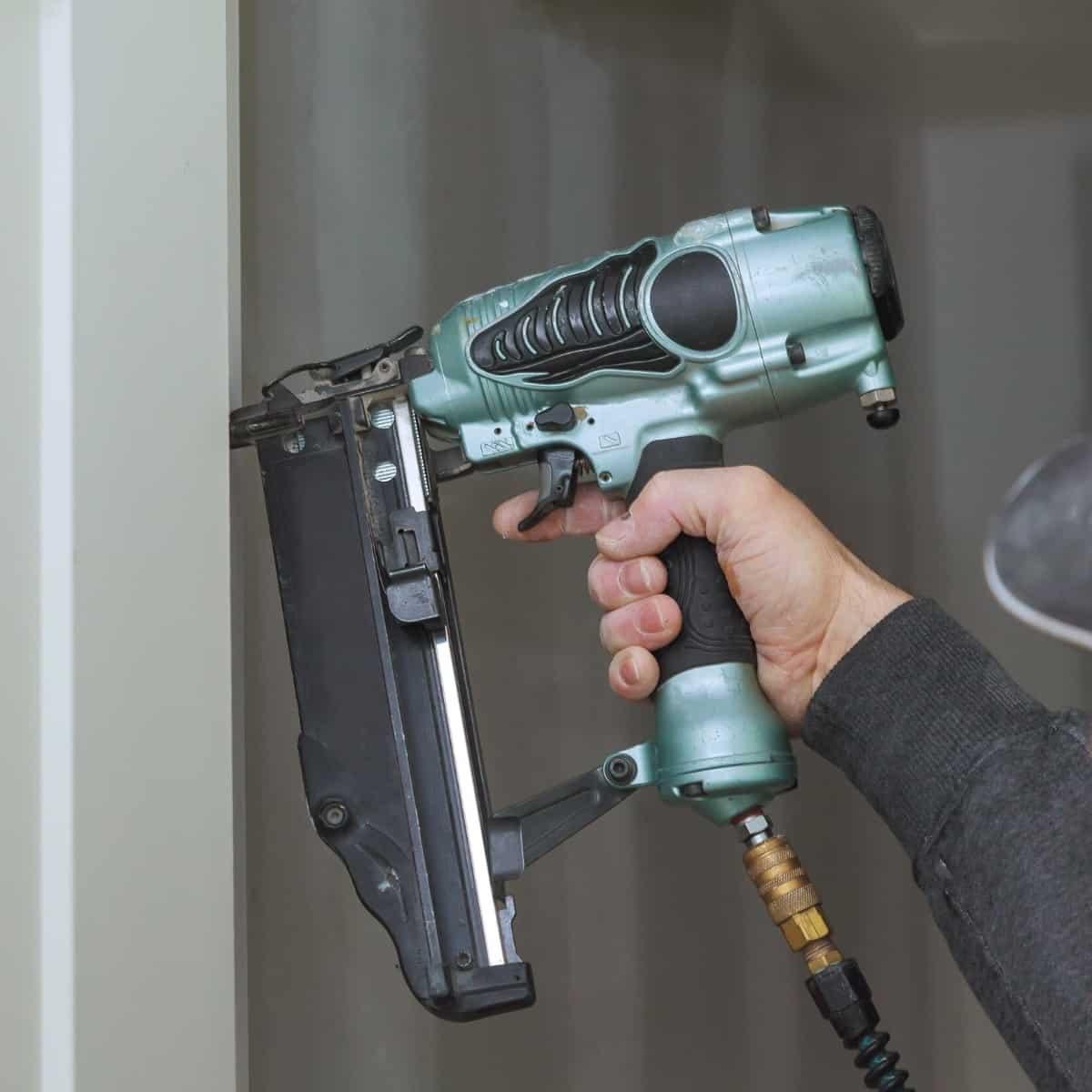 finish nailer attaching door trim